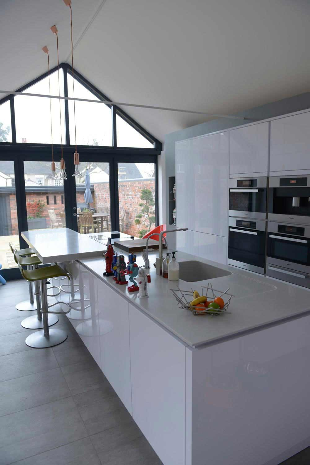 glass gable and doors with vaulted ceiling modern kitchen
