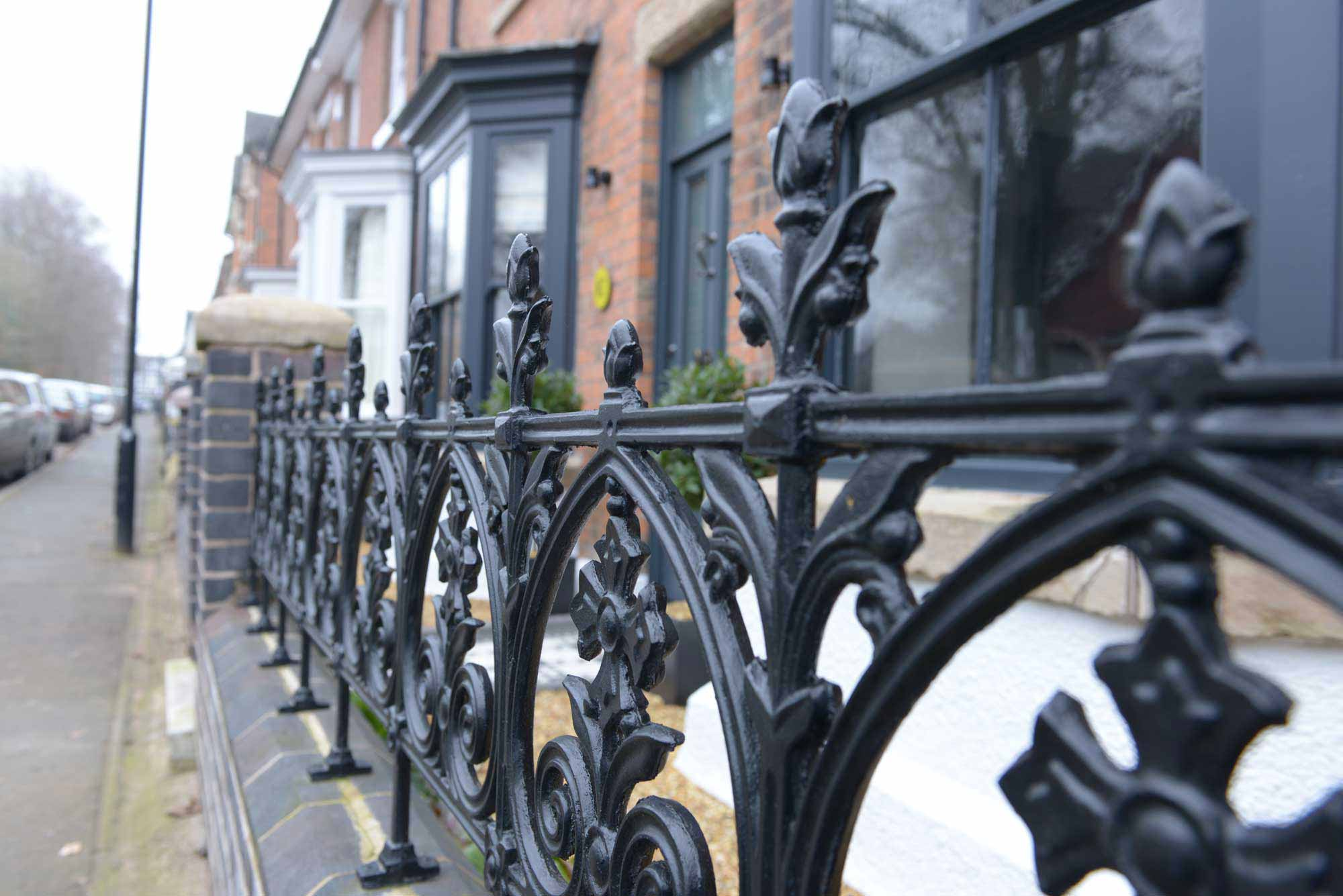 town house cast iron railing on wall