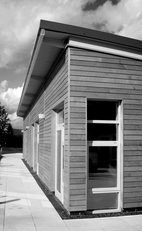 white aluminium windows with oak timber cladding