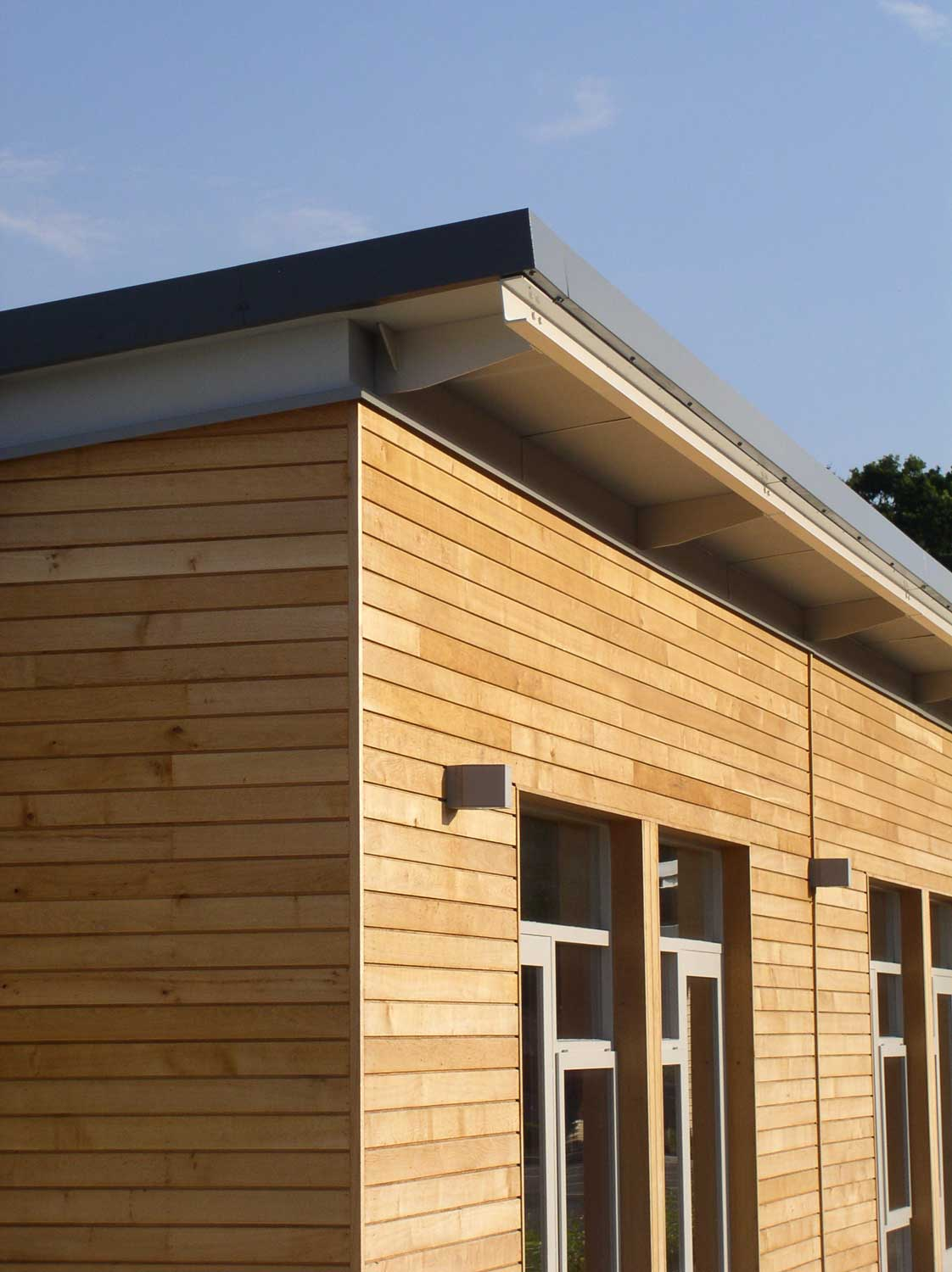 mono pitch roof and oak timber cladding