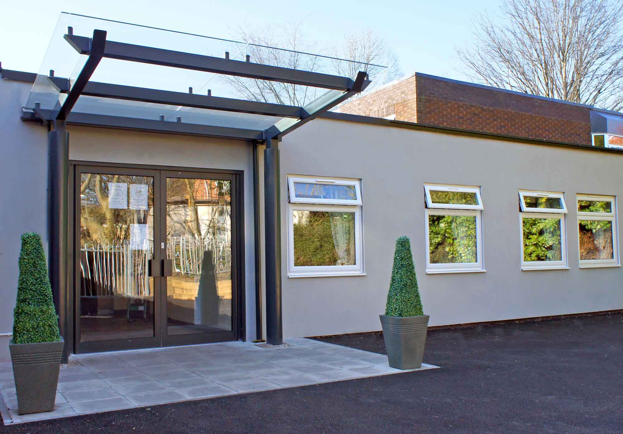glass canopy entrance to care home