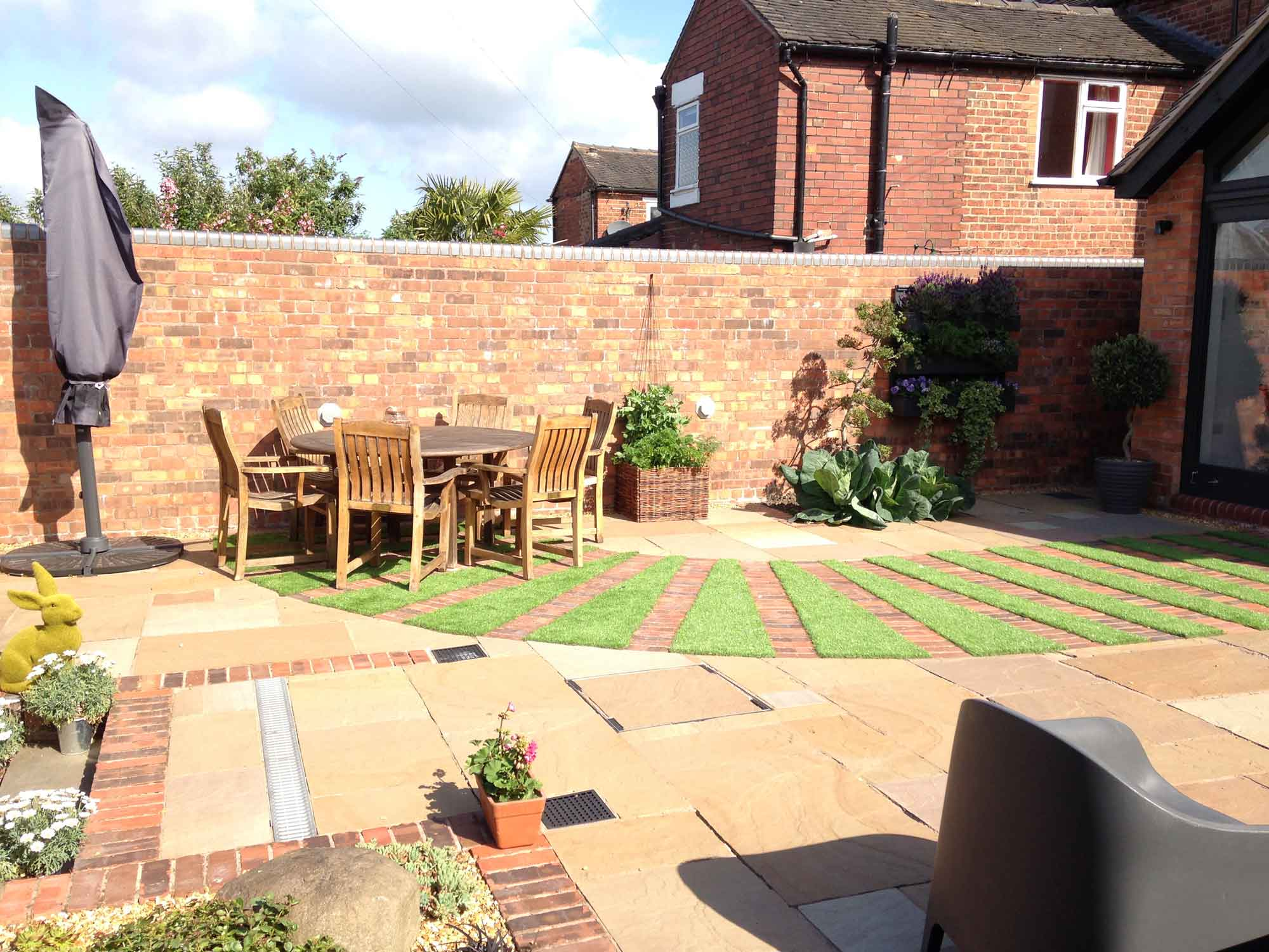 garden terrace astro turf Indian stone paving