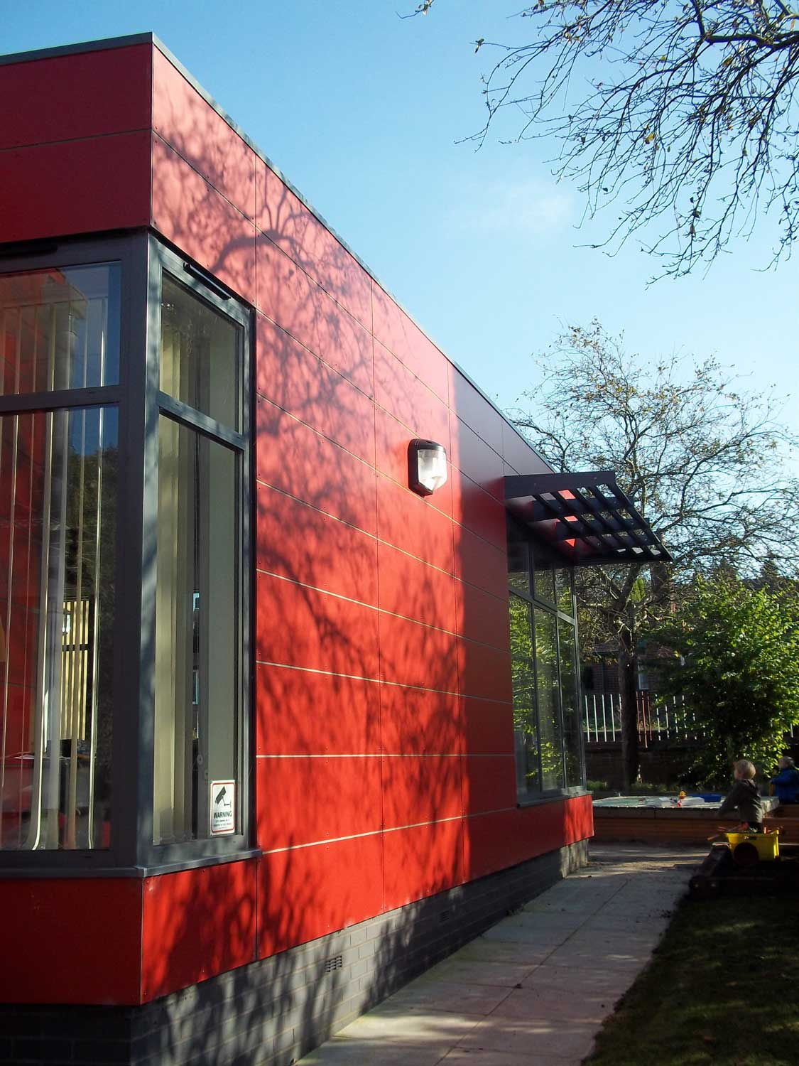 new nursery school building with red cladding and aluminium windows