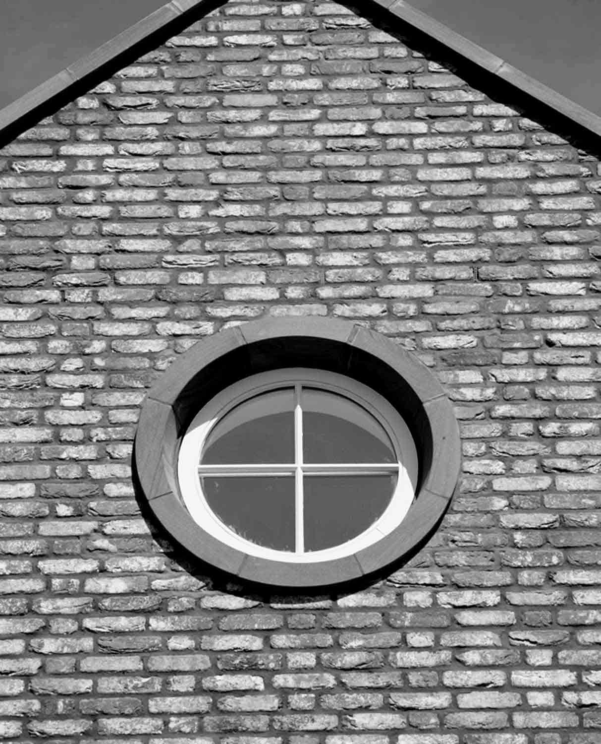 stone surround porthole window timber