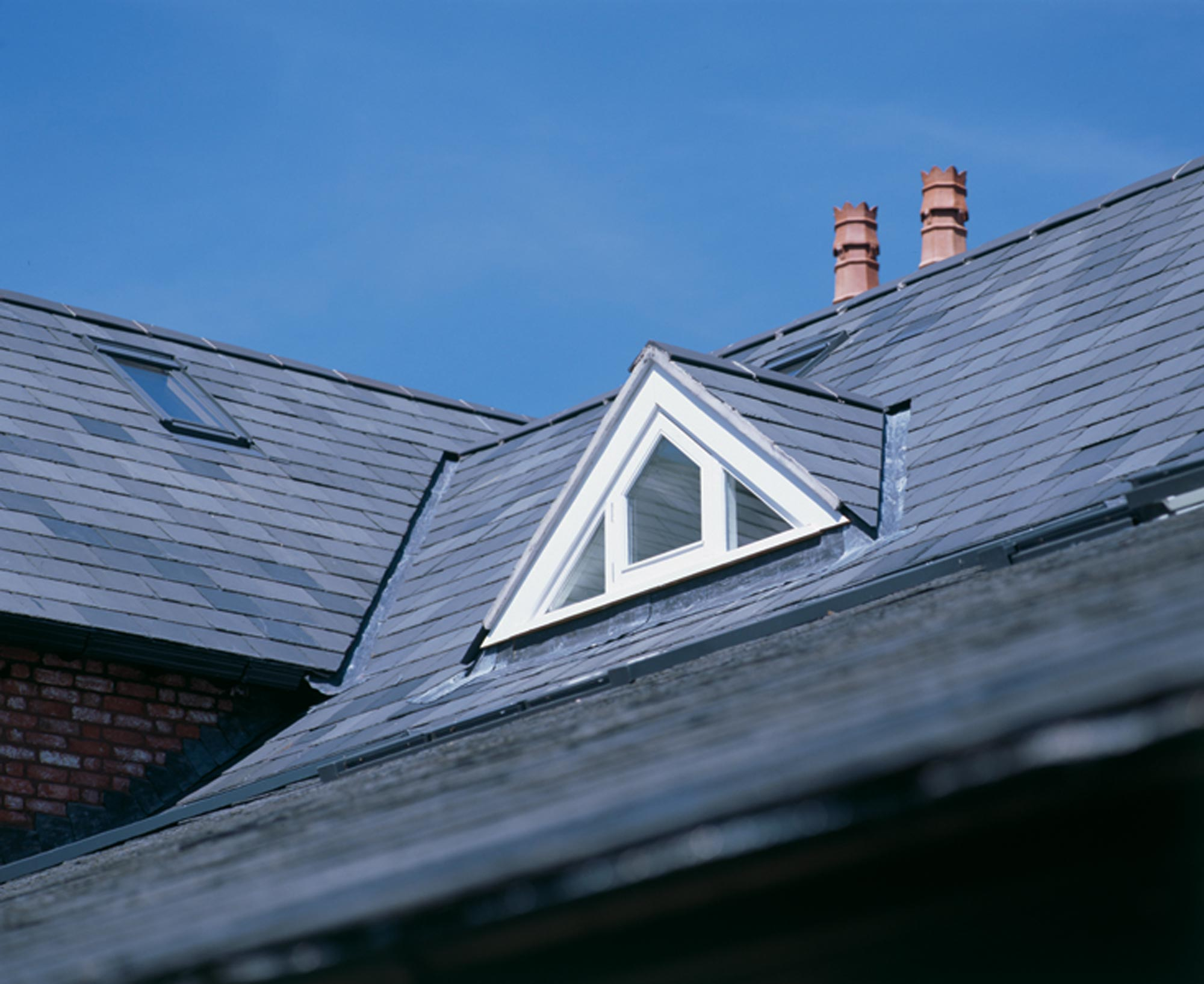 slate roof triangle dormer window and roof lights