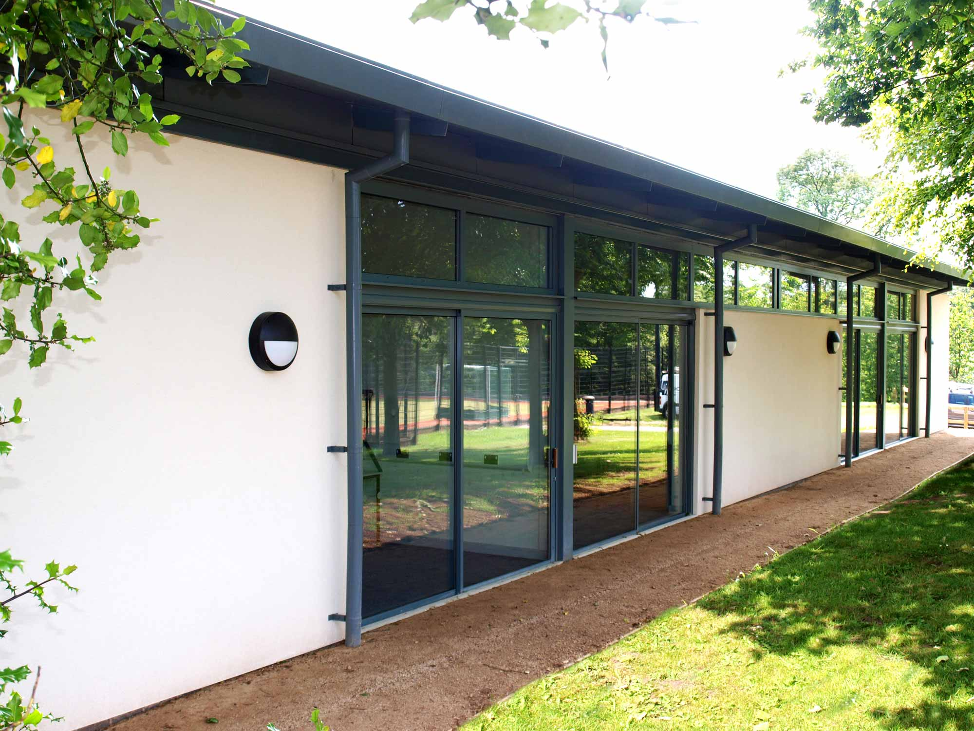 summer school and college classroom with aluminium windows and render finish