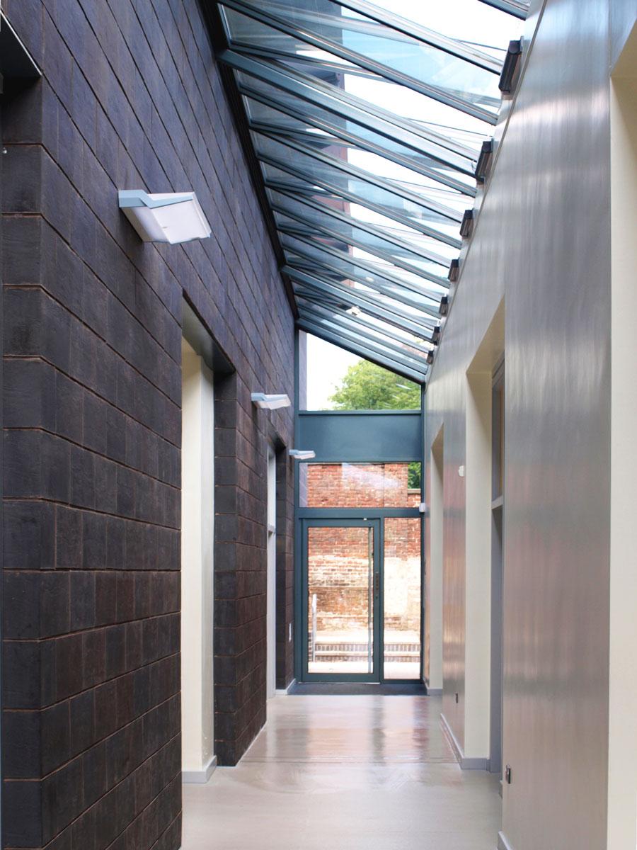 glass atrium corridor to classrooms