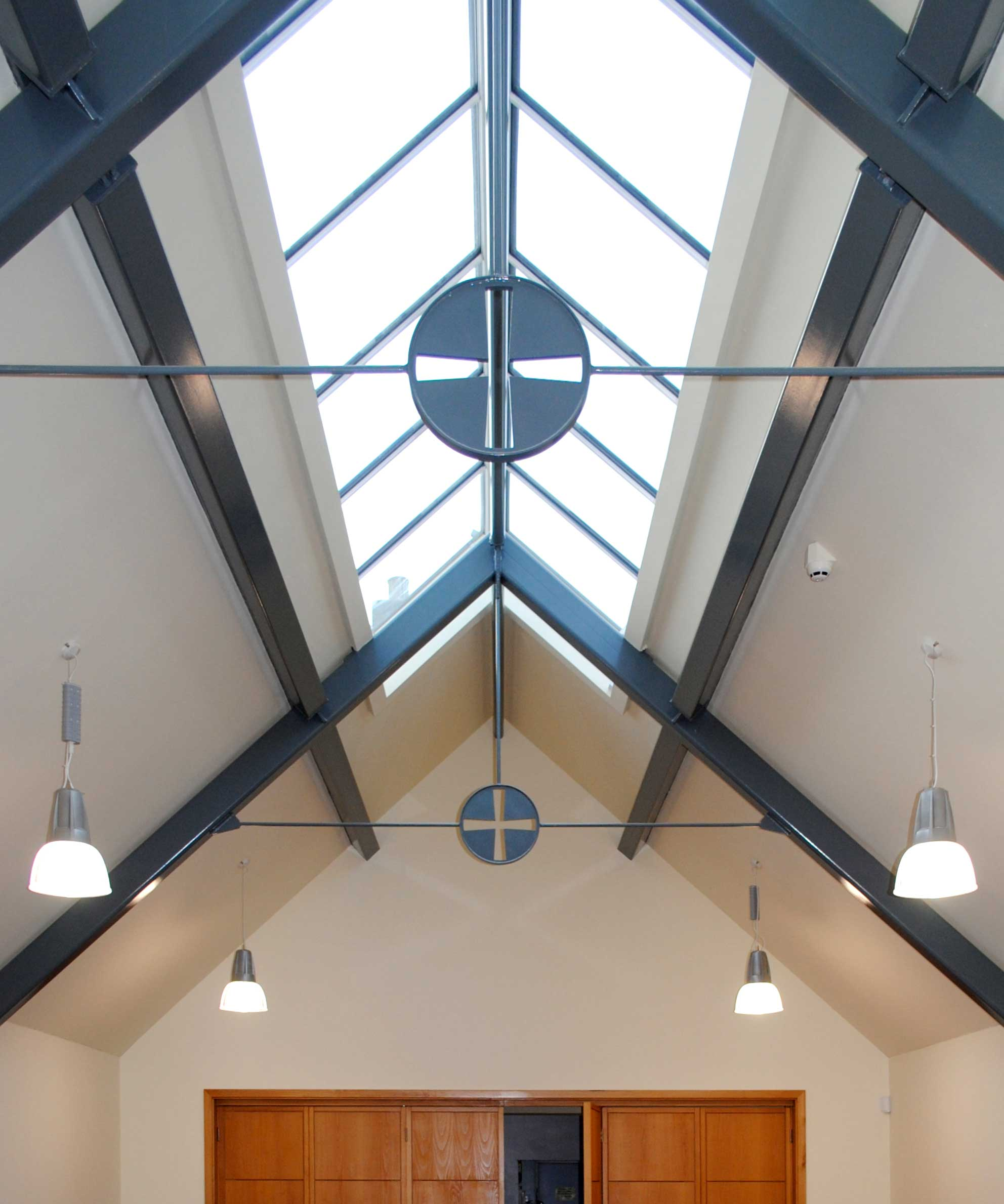 roof lantern and exposed steel rafters and purlins