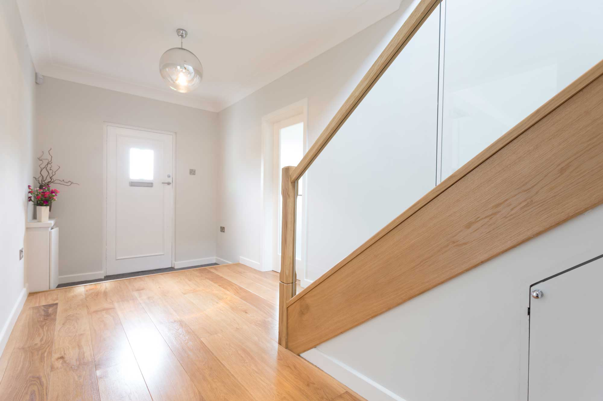 hardwood flooring hallway and staircase