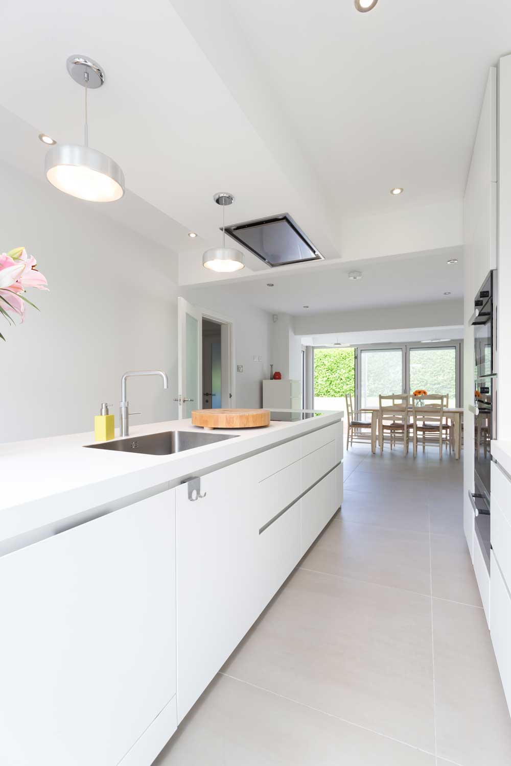 white kitchen modern sink island