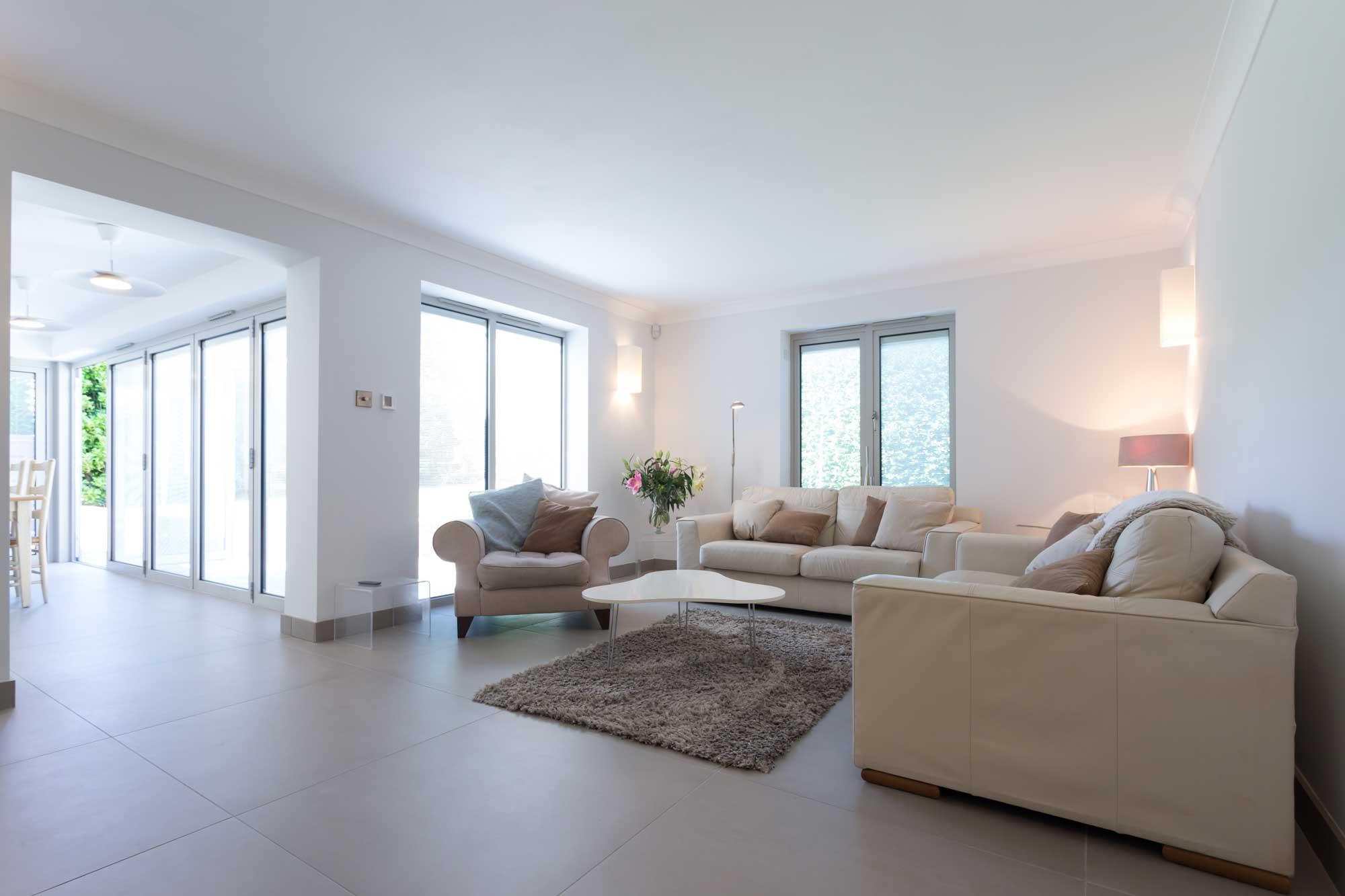 modern white lounge living room sofa large windows