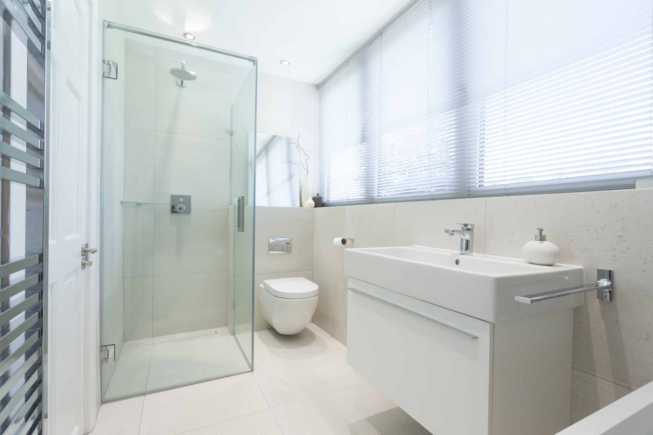 modern tiled full shower bathroom and his and hers sink unit