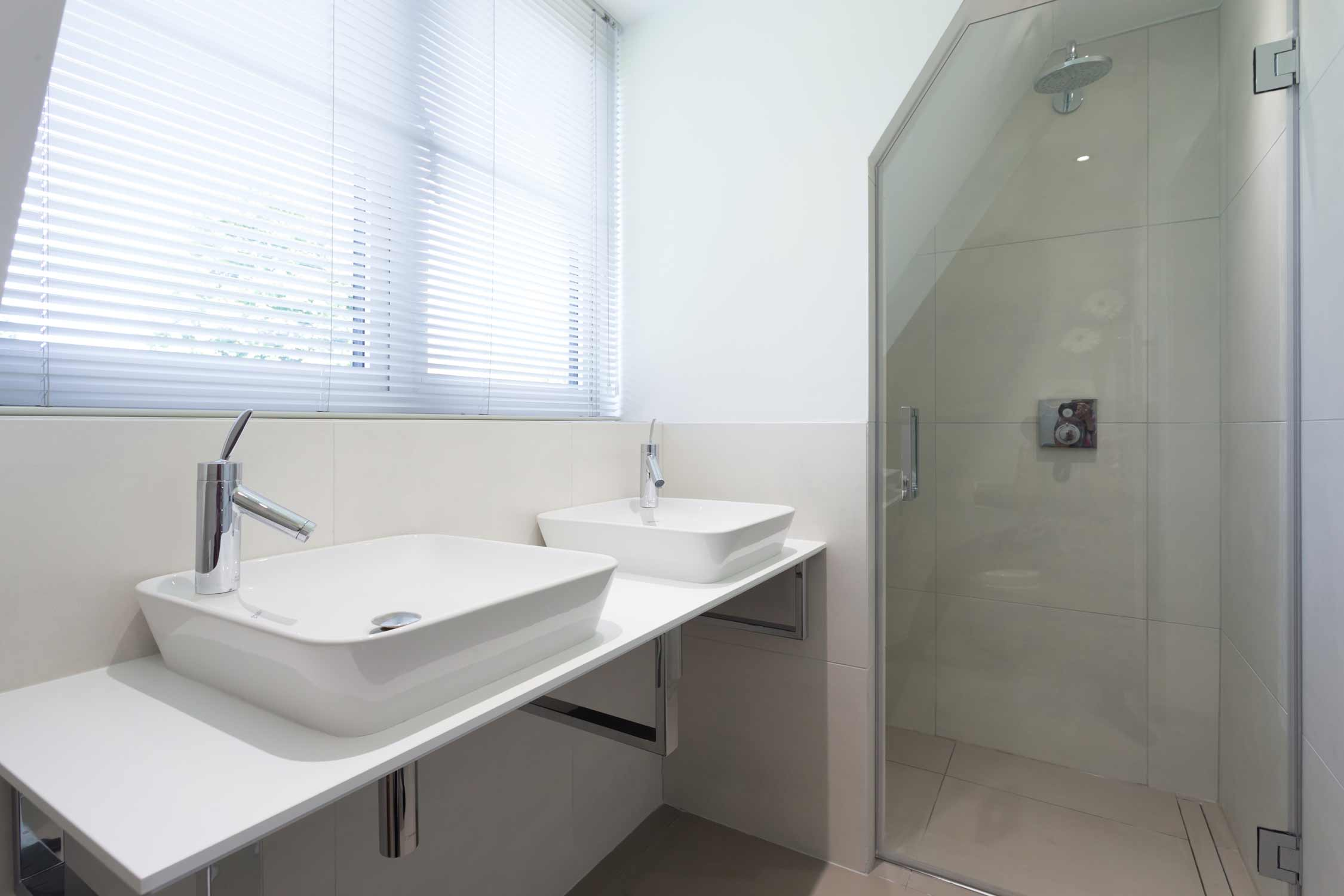 his and hers sink unit and shower