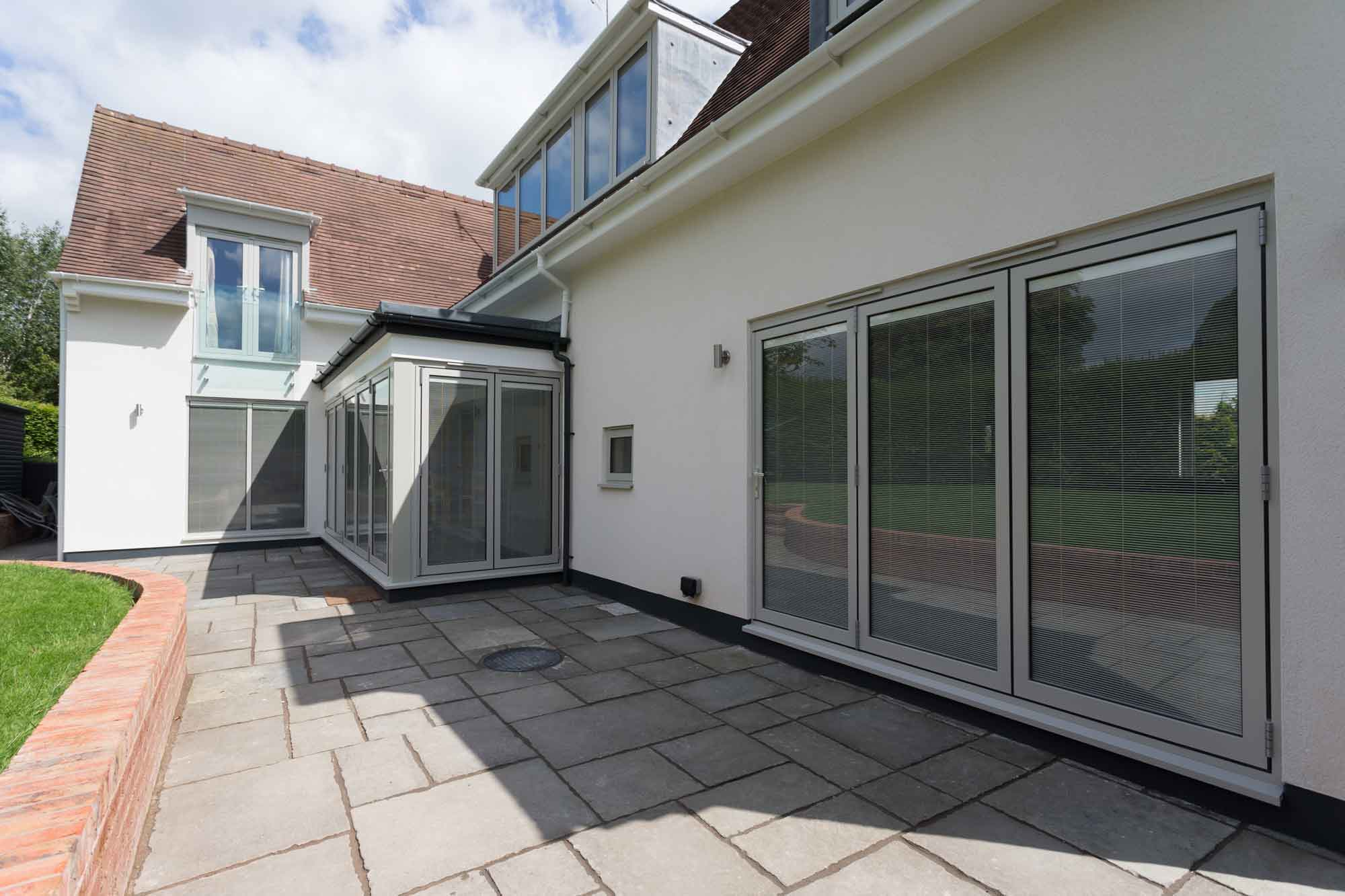 bi-fold doors grey Indian stone paving