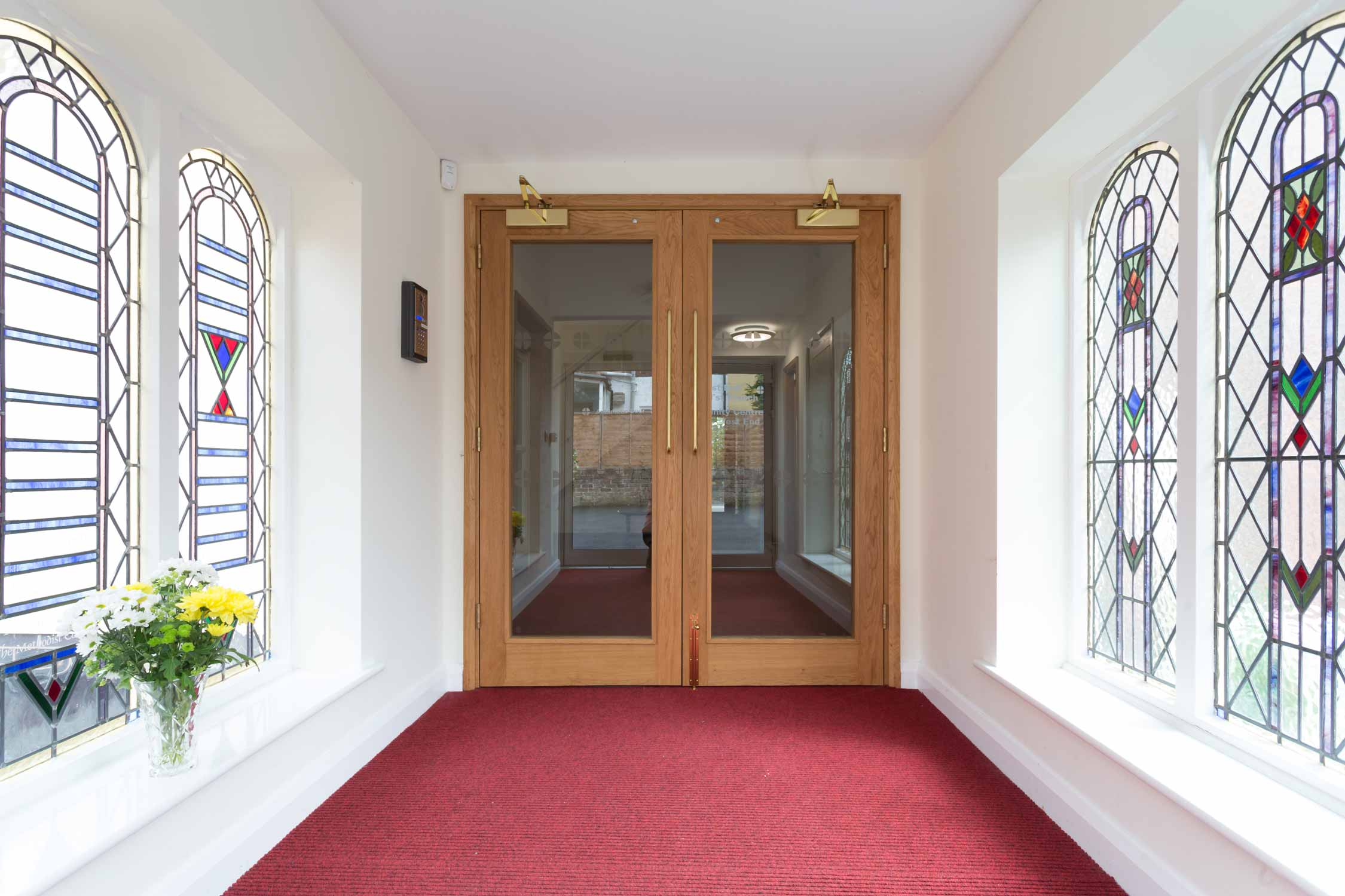 stained glass entrance lobby hall oak glass doors