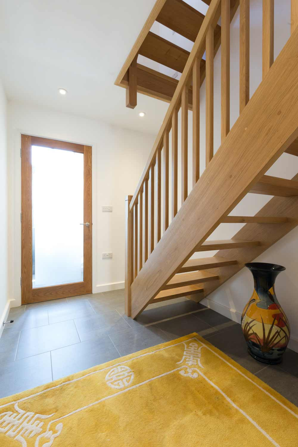 oak open tread staircase entrance hall full glazed door
