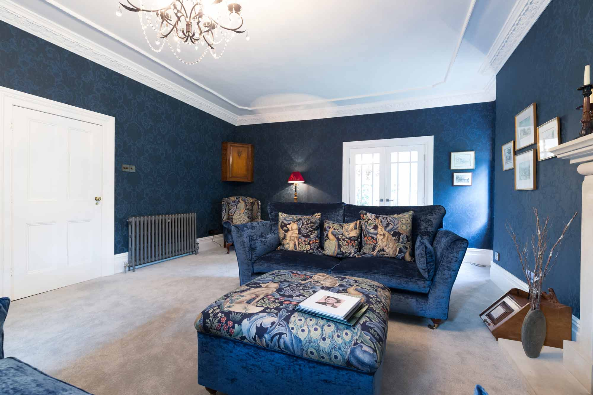 cornice, floral wallpaper, antique radiator, georgian fireplace, crushed velvet sofa, georgian panelled doors,