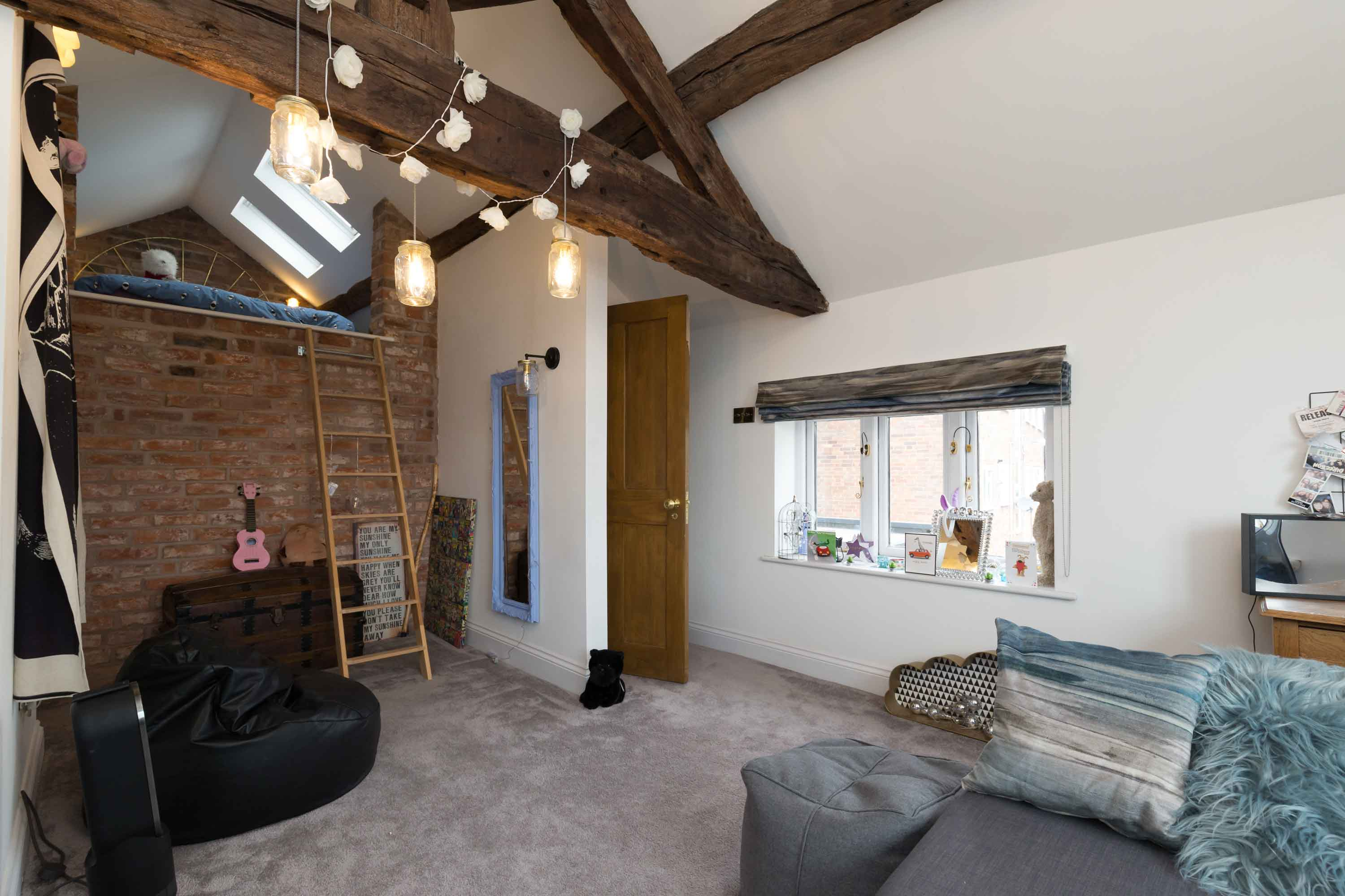 loft bedroom conservation timber beams oak brick wall