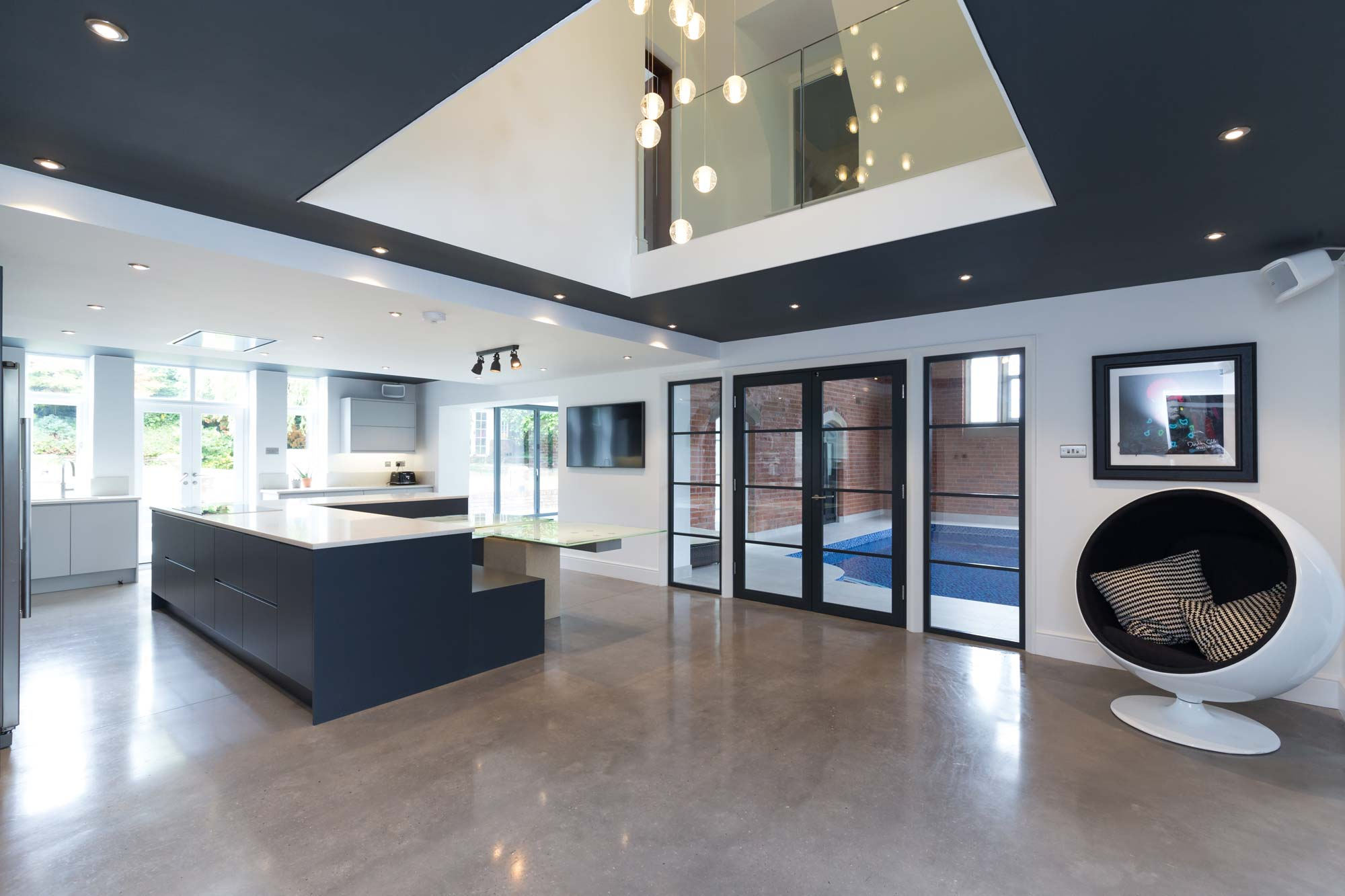 polished concrete floor, open plan kitchen, pool room, double height hall and landing