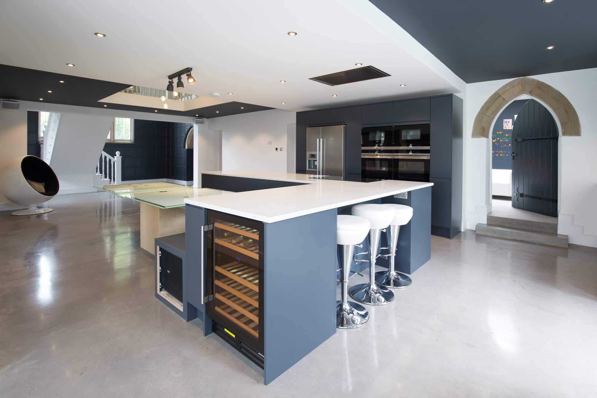 open plan kitchen dining and bench seating bar