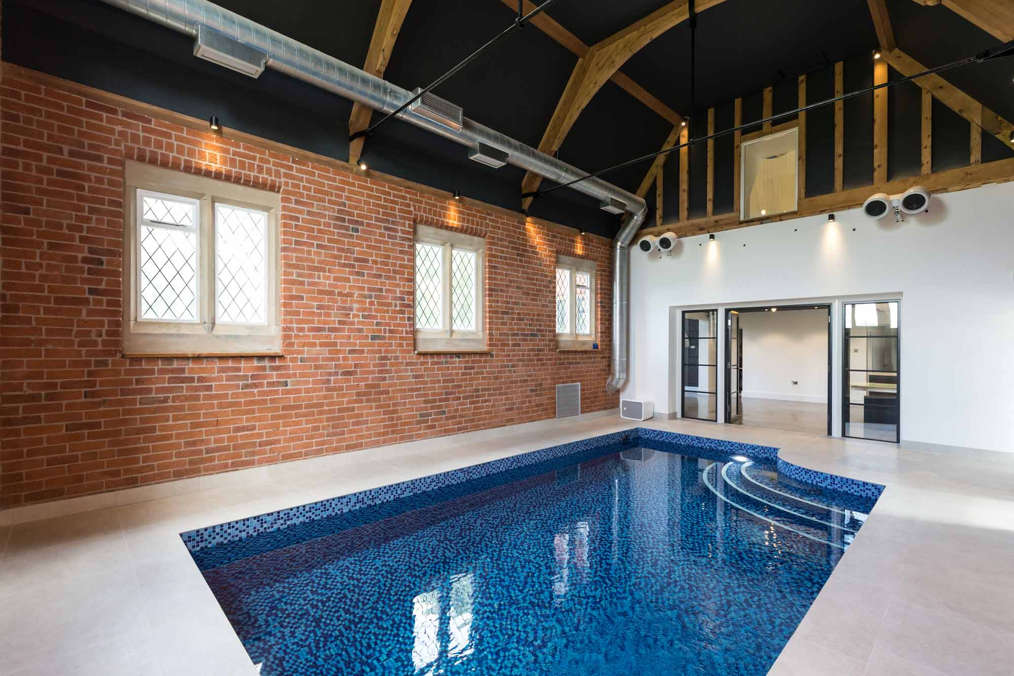 indoor swimming pool listed building ventilation exposed brick stone windows