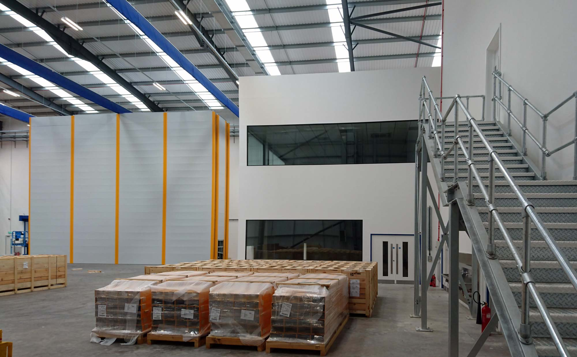 panoramic frameless glass window fire rated glass, galvanised steel staircase, factory floor