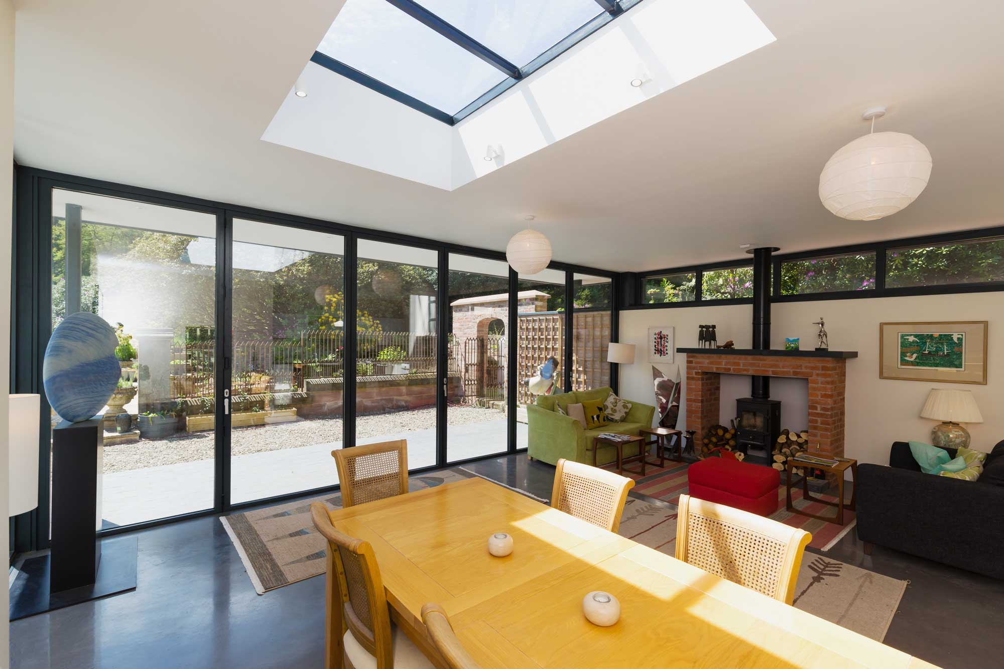flat roof lantern over dining area and full height aluminium bi-fold doors extension to a country house in Baldwins Gate